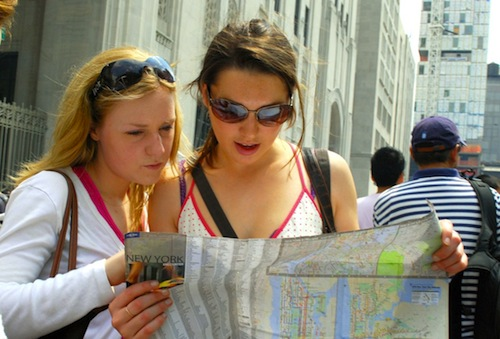 1._Two_girls_reading_map_of_NYC