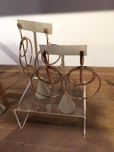 A pair of Gold hoop earings from designer Larissa Loden